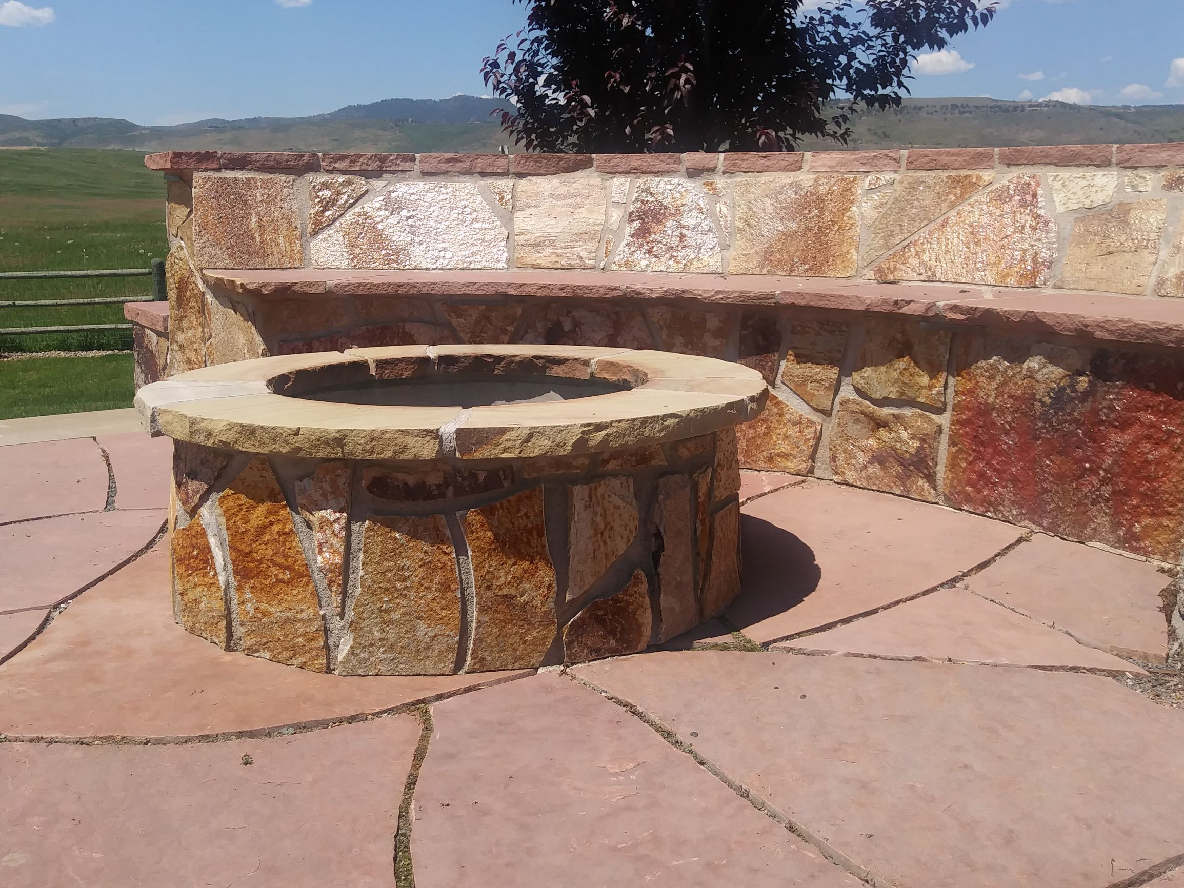 Fire pit with flat stone bench seating.