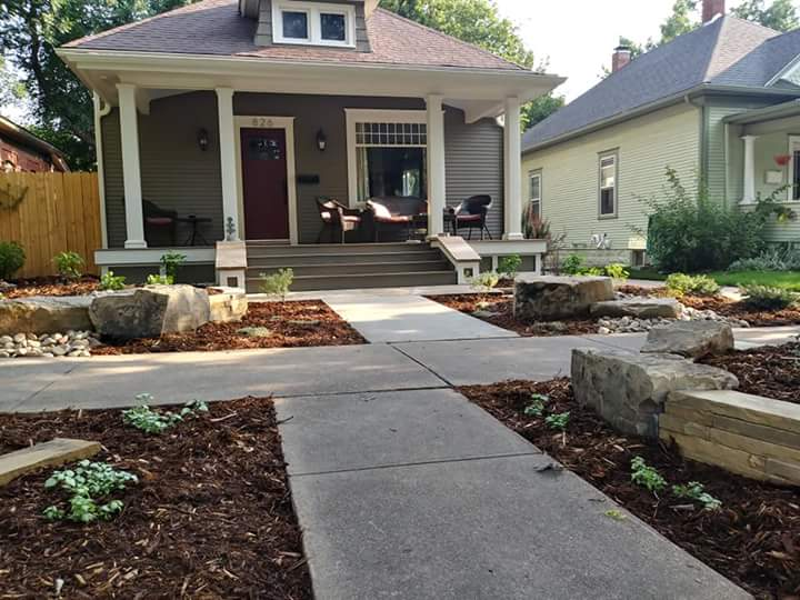 Mulch and low maintenance plants and large decorative rocks.