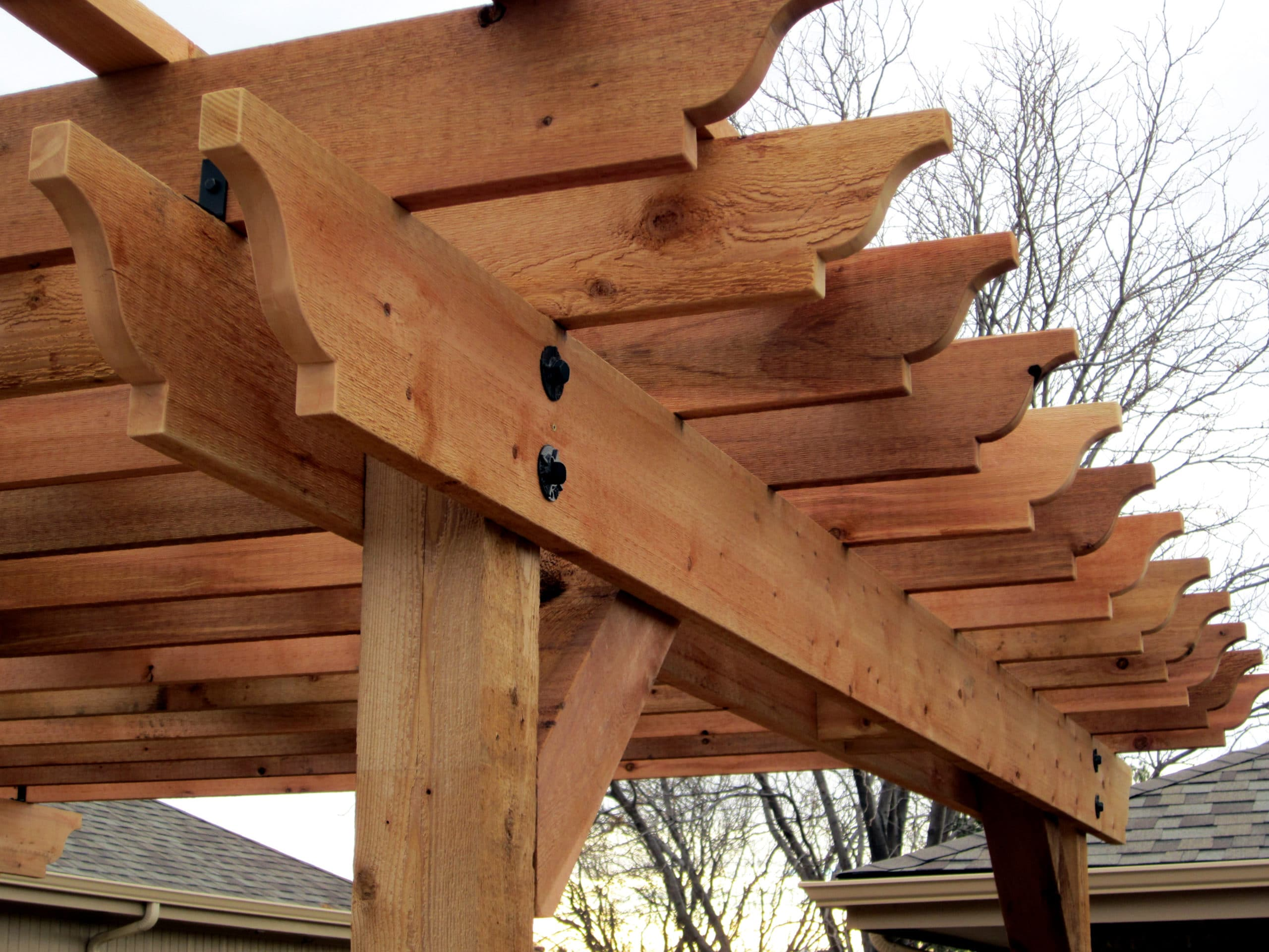 detailed image of pergola ends as well as main supports.